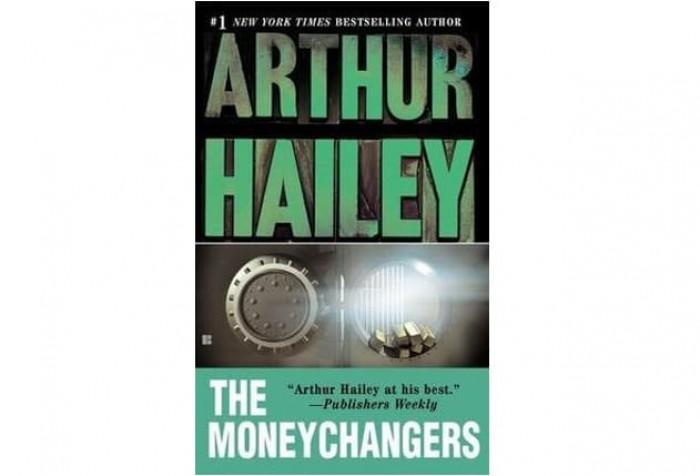 Обложка англоязычного издания романа Артура Хейли «Менялы»