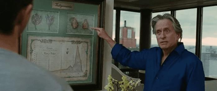 Кадр из фильма «Уолл-Стрит 2. Деньги не спят». Гектор Гекко показывает на гравюру с графиком изменения цены луковиц во время тюльпановой лихорадки.